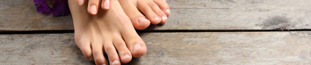 clean feet and hands on wood floor at Beauchamp Foot Care
